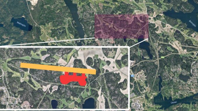 Karta över den planerade flygplatsen. Start- och landningsbanan är gul, terminalbyggnaden är röd.